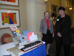 Nancy Poffenberger selling books,  with Rose Brady