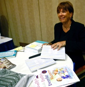Peggy Post signs books
